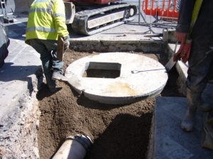 The last manhole cover in place, junction Bridge/Blesdon Rds